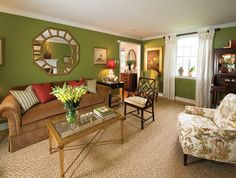 love this living room..love the browns and golds with the green and pops of red from the pillows