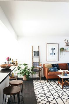 at home with new darlings west elm couch coffee table rug indigo and mudcloth pillows war is over print live edge stools boho ethnic modern - Home Decor Living Room