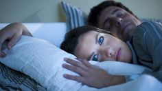 Sleeping in one eight-hour chunk is a very recent phenomenon, and lying awake at night could be good for you, according to scientists and historians.