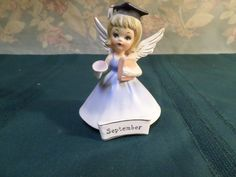 "For sale is a vintage September birthday angel made by Nanco of Boston, MA. The angel measure 4 1/4 "" high x 3"" long base, and is in fine used condition with no chips or cracks, has original silver foil stickers, scuff marks from sitting on shelf.   