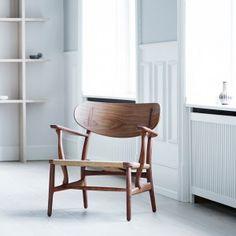 Carl+Hansen+&+Søn+reissues+Hans+J+Wegner's+CH22+lounge+chair