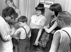 Smallpox vaccination - A family receives their smallpox vaccinations in 1967.