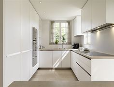"modern ""U"" shaped kitchen, but white would be too stark in our condo"