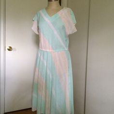 """vintage 80's dress uh, i had """"serenity"""" and """"rose quartz"""" before pantone declared those two the colors of the year. this darling 80's number proves how well those pastels work together, in spite of reminding me of """"miami vice."""" everything old is new again! (42"""" long, 17-18"""" waist, 20"""" from underarm to underarm, no fabric content tag but feels like a blend with mostly cotton) Vintage Dresses Midi"""