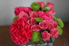 Pink carnations, pink roses, green mums