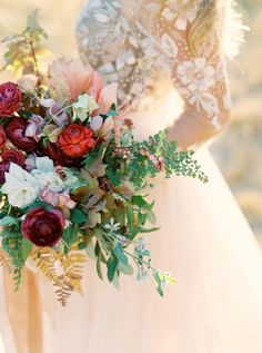 Vibrant fall hued wedding bouquet: http://www.stylemepretty.com/2015/11/27/autumn-bridal-session-in-yosemite-national-park/ | Photography: Cassidy Carson - http://www.cassidycarsonphotography.com/: