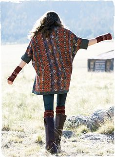 Motifs from an Anatolian kilim pattern this kimono-style cardigan in rich hues of persimmon, sage, lavender and twilight. A lofty, textural, jacquard knit in baby alpaca (60%), pima (30%) and nylon (10%), with contrasting stripes inside and elbow-length dolman sleeves.