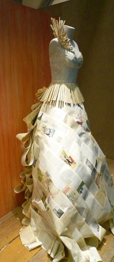 Amazing dress from used book pages! It's an Anthropologie window display. #textbookcrafts #textbooks