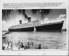 Queen Elizabeth at Port Everglades in 1977- a tragic ending for a magnificent lady- I was honored to spend time aboard her-