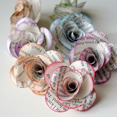 Another example of what to do with pages from a book that's fallen apart. I've never tried to make book flowers, but found links to tutorials here.