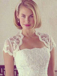 Wedding hair. Short bob with one side swept back with a comb.