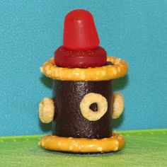 Fire Hydrant made with pretzels, candy and Cherrios #FoodArt #kids #firehydrant #fireman #party