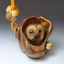 "Netsuke of owl in a hollow tree with ojime of a mouse on a mushroom. Carved by Sergei Osupov. Crimean juniper wood, amber and horn inlat. The ojime is carved tagua nut. A haiku goes with it:   ""Having heard a mouse Eating a mushroom The owl is now on guard..."""