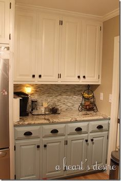 Cabinet Paint: Top, Behr Swiss Coffee Bottom, Benjamin Moore Gossamer Blue, granite is Cosmos granite color Vintage