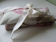 How to make a foot warming pillow using flax seed. Add a little essential oil for extra luxury! Just warm it in the microwave and it will stay warm for an hour or more. With cold weather upon us, it'll make a great gift and definitely keep one for yourself. (An Oregon Cottage)