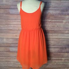 ❤ LUSH Orange semi sheer dress Fun flirty and flowy! This dress is perfect for spring and summer! Adjustable straps and scrunch waist! Measures 17.5 inches from scrunch waist ! Tag says XS but could fit small as well Lush Dresses Mini