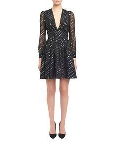 "<ul> <li>A flared silhouetted enhanced with lovely lace</li> <li>Roundneck</li> <li>Cap sleeves</li> <li>Concealed back zipper closure</li> <li>Banded waist</li> <li>Shirred skirt</li> <li>Fully lined</li> <li>About 19"" from natural waist to hem</li> <li>Polyester/viscose/cotton/polyamide</li> <li>Dry clean</li> <li>Made in USA</li> <li>This item will arrive with a tag attached and instructions for removal. Once tag is removed, this item cannot be returned.</li> </ul>"