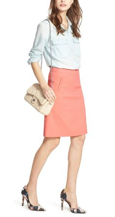 Pairing a classic denim shirt with a coral skirt and pumps for a chic 9-to-5 look.