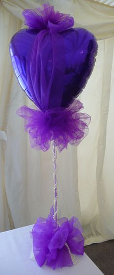 Purple heart centrepiece with tulle and pearls