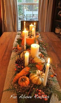 Nice for Thanksgiving. Box, pumpkins, candles, bittersweet, pinecones, greens, twigs.