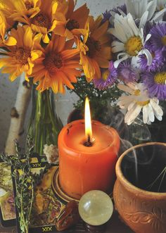 #litha #summersolstice #solstice #lithaaltar #lithacandle #witchcraft #crystalball #flowers #summer #tarot #herbalcandle #herbalwitchcraft #nature  - www.thepaganwitch.com