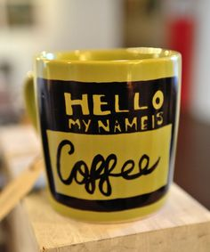 'Hello, my name is Coffee' Mug    Hand painted green mug. This is a good sized mug, ready for a good cup of coffee!  As mug is hand painted, please treat with care. He doesn''t like the washing machine or scourers!    $18    http://matchboxstudios.co.nz/boutique-unique-designs/homewears/tea-total-mug-duplicate/#