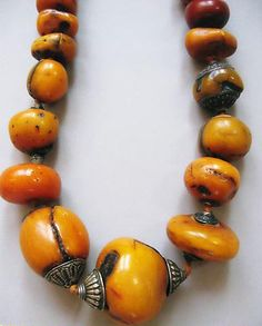 Large amber beads with silver ends, Tibet 17th / 18th c.