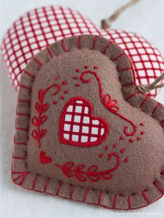 stitched hearts ... love the colors and folkstyle detailing
