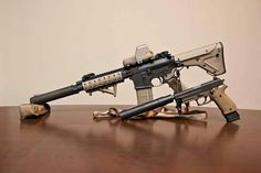 AR 15 SBR suppressed with EOTech, Sig Sauer P226 suppressed with extended magazine