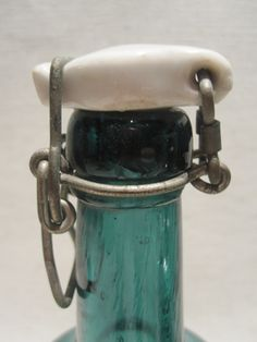 c 1890 blue glass Swedith beer bottles topped with porcelain bottle stopper