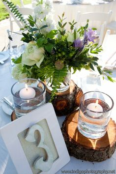 I like the flower arrangements with country like setting. The floating candles are pretty too.