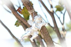 Silver Cupid feeling the love! Hanging tree decor by www.brisbaneweddingdecorators.com.au