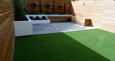 modern garden design courtyard easy lawn grass cedar hardwood privacy screen trellis low maintenance planting sandstone patio paving London (4)