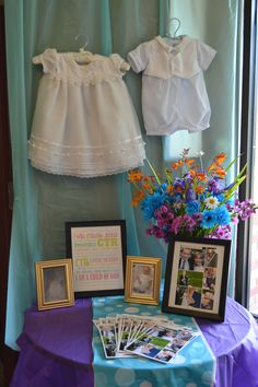 LDS Baptism program table. We displayed our kid's blessing clothing, baby blessing picture, and a framed baptism program