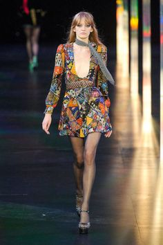 Designers are taking a trip back to a deep caramel, burgundy, orange and emerald-hued 1970s. With large-lapel jackets done up in leather and suede at Prada and  Chloé, fit and flares at Emilio Pucci,  patchwork dreams from Vuitton and Derek Lam, and platforms and minidresses made for dancing at Saint Laurent—it's a seriously groovy season. Pictured: Saint Laurent
