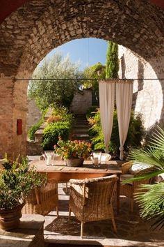 Pretty incredible outdoor space. Love the dividing curtains outdoors.