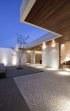 up lighters and wall spot lights | garden lighting || Gedda House by Mustafá Bucar Arquitetura