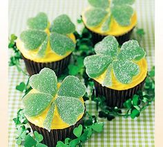 Cupcakes w/ shamrocks  made from green spearmint candy leaves