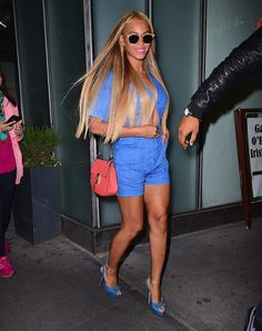 World, meet Beyoncé's take on the Canadian tuxedo—a denim romper and denim heels.