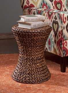 Salton Banana Leaf Ottoman - In an hourglass shape, woven banana leaves create the natural look of the Salton ottoman. Great for use as a side table, this ottoman adds a warm honey tone to any room.