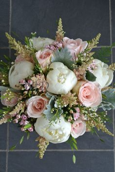 Brides bouquet, Peony, waxflower, Astilbe, Roses created by Wild Floral Designs.