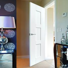 The Jbk Symmetry Geo White Primed Panel Door is 30 Minute Fire Rated, well priced and with free delivery. #whitefiredoor #firedoor #modernfiredoor