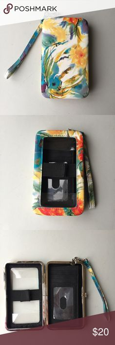 Beautiful colorful tech wristlet This wristlet has a gorgeous watercolor pattern with floral detail. Blue, green, white, yellow, orange, purple, and red. Fits many types of phones with access to the smartphone screen when it is closed. Seems to be shaped for an iPhone, but similar sized phones would work also because it's not precise sizing. Room for cards, ID, and cash as well. Detachable strap. Very pretty case wallet for everyday use! Bags Clutches & Wristlets