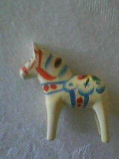 Annons på Tradera: Dalahäst liten miniatyr häst retro