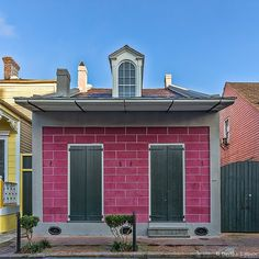 """Circa 1830 Two-bay Creole Cottage on Burgundy St. French Quarter New Orleans. Property transfer records from 1884 show this description: """"...a handsome brick residence having hall parlor dining-room with sliding door two bedrooms and cabinet two bedrooms and four closets in the attic; a two-story brick building in the yard having four rooms cellar privy waterworks flagged yard. In the back part of the yard a frame building of three rooms and cistern etc."""" 