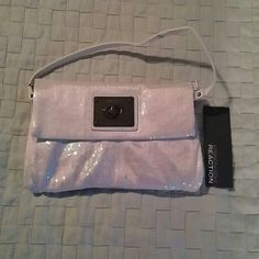 "Kenneth Cole sequin purse clutch Color: white Sparkles in light New with tags 4 slots inside Strap can belong enough to wear as crossbody. Size: 6"" deep x 11"" wide Kenneth Cole Reaction Bags"