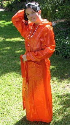 Adele wearing a long orange pvc mackintosh Red Raincoat, Vinyl Raincoat, Raincoat Jacket, Plastic Raincoat, Plastic Pants, Hooded Raincoat, Rain Jacket, Adele, Imper Pvc