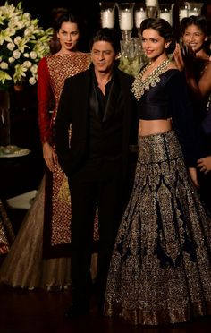 Deepika Padukone presents a creation by Indian fashion designer Manish Malhotra during the Grand Finale of PCJ Delhi Couture Week 2013 in New Delhi. (AFP)Shah Rukh Khan, Indian fashion designer Manish Malhotra and Deepika Padukone pose during the Grand Fi Indian Bridal Wear, Indian Wedding Outfits, Indian Outfits, Blue Bridal, Bollywood Stars, Bollywood Fashion, Pakistani Dresses, Indian Dresses, Latest Bridal Lehenga