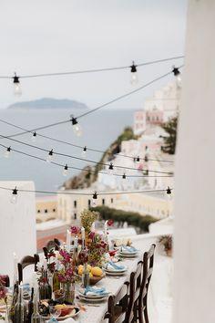 outdoor destination wedding reception - photo by Monica Leggio http://ruffledblog.com/italian-island-elopement-inspiration/