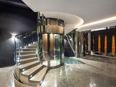 Trendy: A spiral staircase curves around a glass lift shaft giving residents options over how to get around the house Stair Elevator, Elevator Design, Glass Elevator, Modern Staircase, Spiral Staircase, Staircase Design, Staircases, Round Stairs, Glass Lift